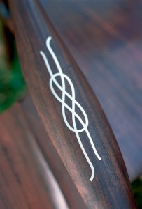 Silver inlay on the arm of the Conversation Chair. It represents the Lover's Knot ~ easy to tie, will never slip, easy to separate. Probably invented offshore of Nova Scotia.